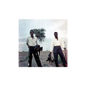 Nikolay Drachinsky. Governor's Managers Roduan and Cambel After Successful Hunting Nearby Settlement of Dinka Tribe. Area of the City Al Manaqil, Upper Nile Province. Sudan, 1957. © Nikolay Drachinsky archive, courtesy of Alla Vakhromeeva, Archive Paper 14x14, $500